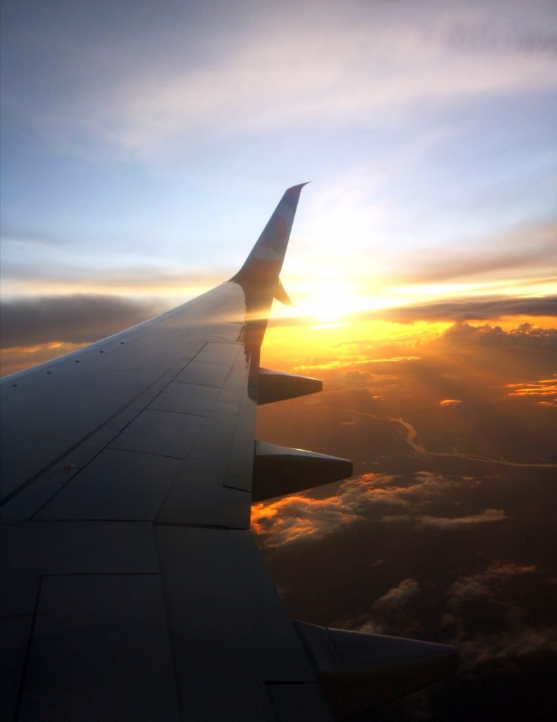 view from plane window at sunset